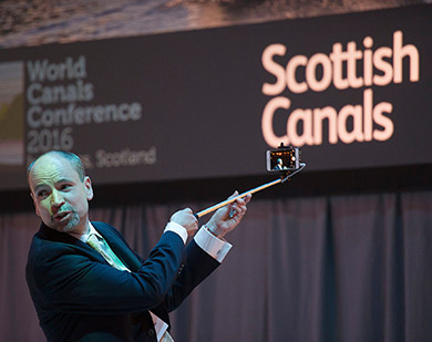 Richard Millar takes a selfie with delegates during the opening session of the WCC